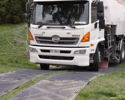 ProtectaMats Used By Facilities Maintenance Contractor Sweeper Truck On Grass