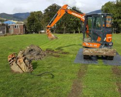 Excavator Using ProtectaMats Ground Protection Mats Showing Ruts Made