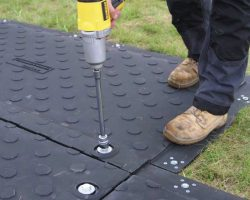 Unique Fast Interlocking Mat Connection System On MaxiTrak GROUND PROTECTION Mats